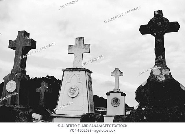 Graves and crosses in the cemetery of Niembro, Llanes, Asturias, Spain
