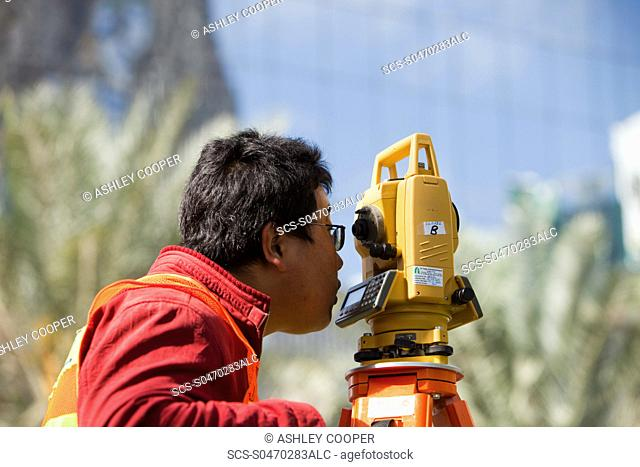 A surveyor working on a construction project in Dubai