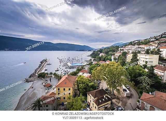 Arial view of Herceg Novi city on the Adriatic Sea Bay of Kotor coast in Montenegro, view with marina and Jadran swimming pool