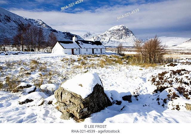 Black Rock Cottage with Buachaille Etive Mor in distance on snow covered Rannoch Moor, near Fort William, Highland, Scotland, United Kingdom, Europe