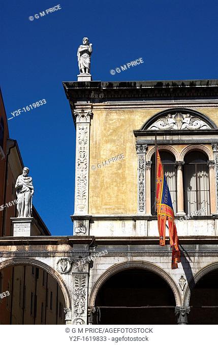windows, arches and statues in Piazza dei Signori, Verona, Italy