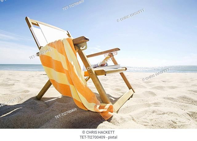 Sun chair on sandy beach