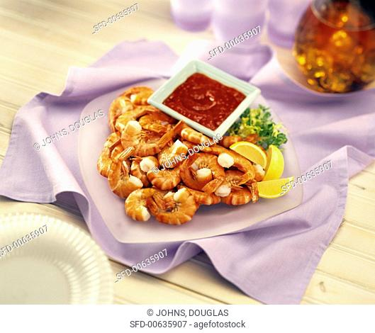 Boiled shrimps with spicy tomato dip