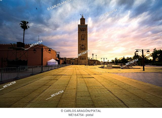 Koutoubia mosque in the sunset with the mats in the foreground to pray Ramadan, Marrakech, Morocco