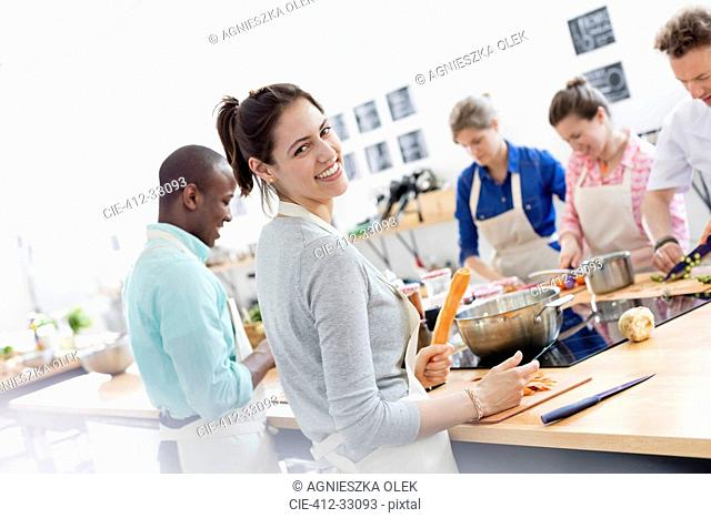 Portrait smiling woman enjoying cooking class in kitchen