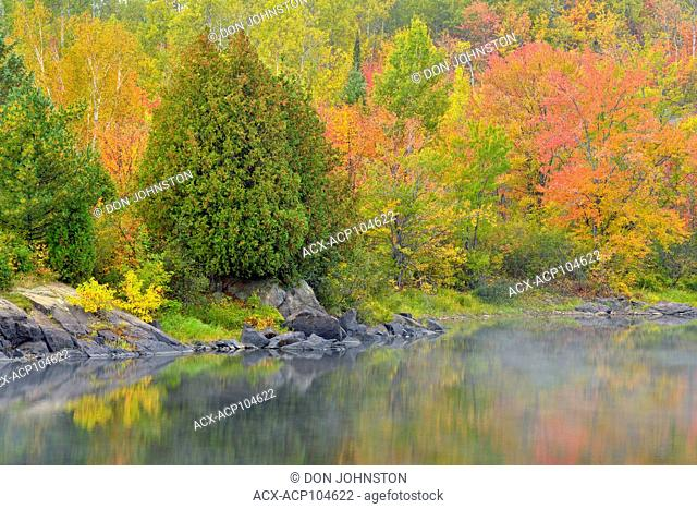 Autumn colour reflected in the Vermilion River, Greater Sudbury, Ontario, Canada