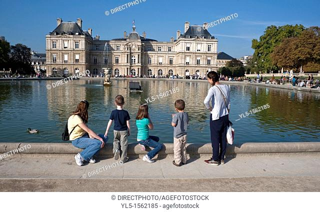 Paris, France, Young Family Relaxing in Urban Park, Jardin du Luxembourg, Autumn Season, Pond