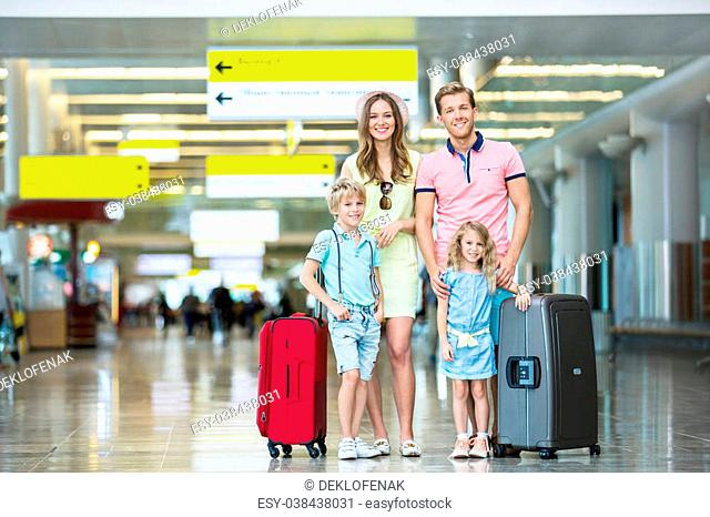 Family with luggage at the airport