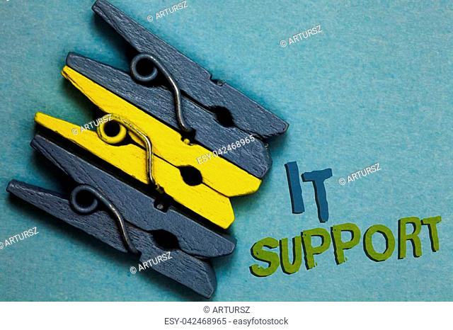 Conceptual hand writing showing It Support. Business photo text Lending help about information technologies and relative issues Gray yellow vintage clothespins...