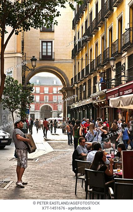 Late afternoon in the Calle de Zaragoza, with the Plaza Mayor in the background, Madrid, Spain