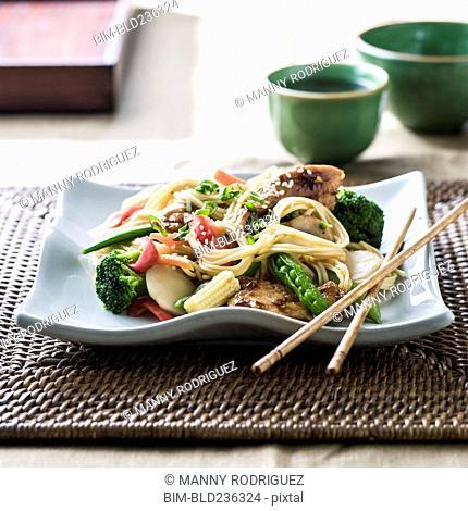 Stir fry on plate with chopsticks