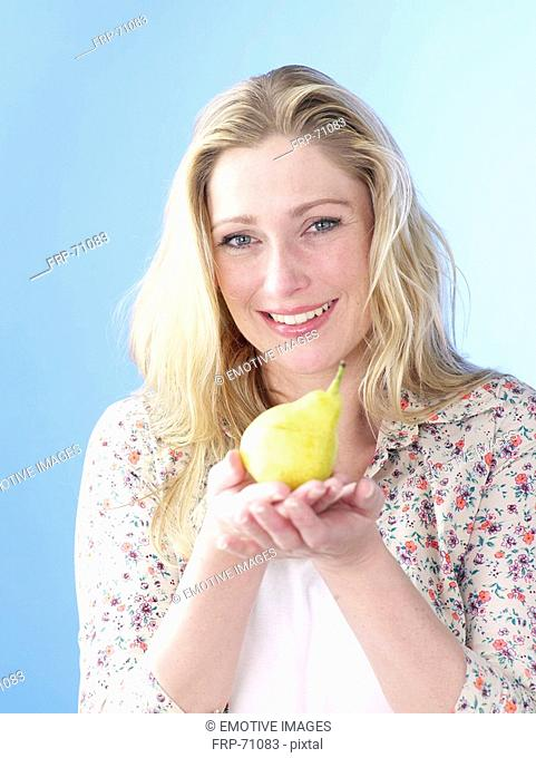Blonde woman with pear