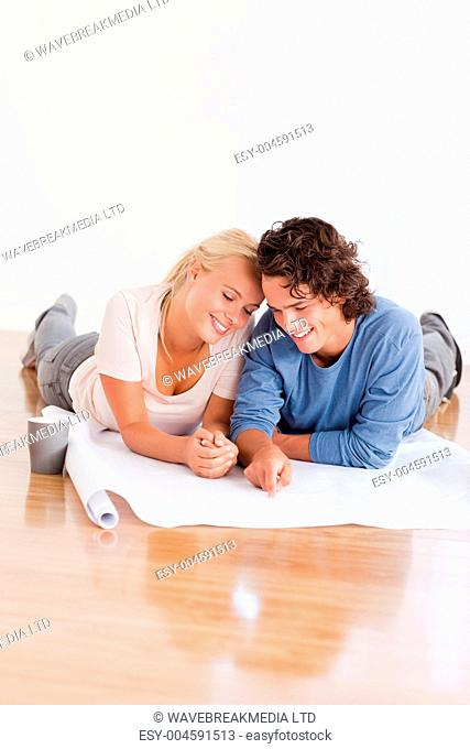 Portrait of a young couple organizing their new home