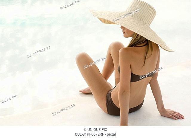 Woman in a swimsuit and large hat