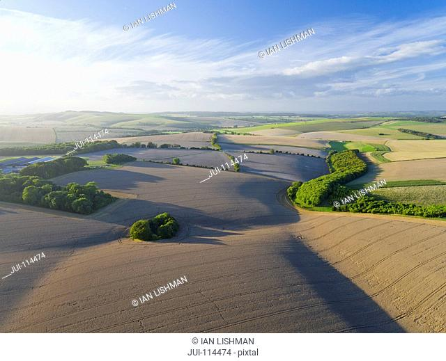 Aerial View Of Farm Fields With Blue Sky