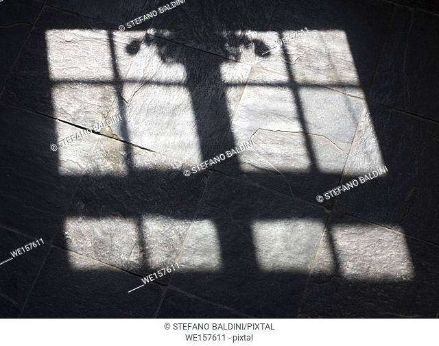 Sunlight from window on a tiled floor