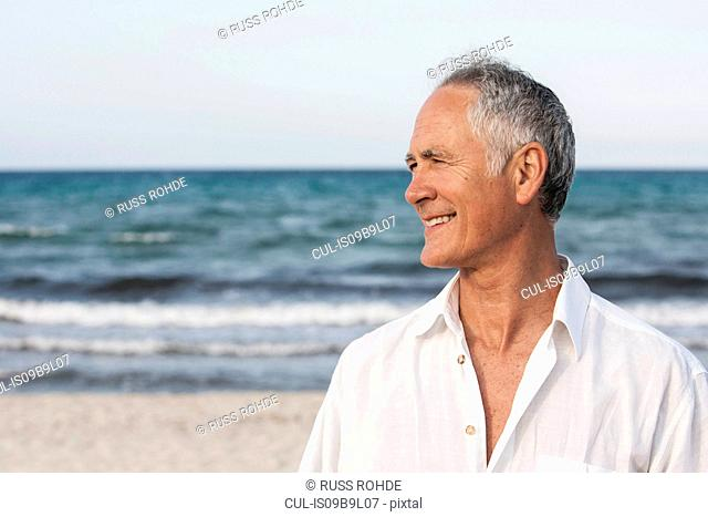 Portrait of senior man by seaside, Palma de Mallorca, Spain