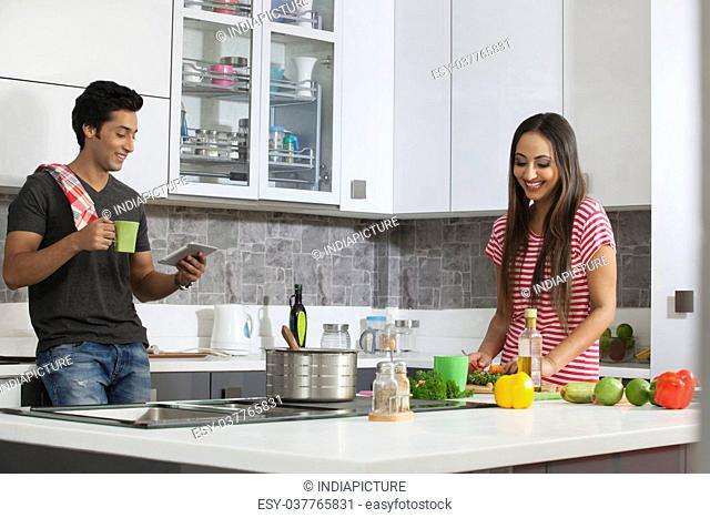 Couple cooking using digital tablet