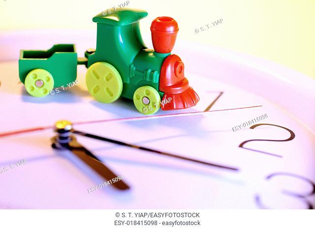 Toy train on clock