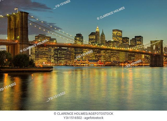 Brooklyn Bridge, East River, South Street Seaport, and lower Manhattan skyline at dusk, as seen from Brooklyn Bridge Park, New York City, New York, USA