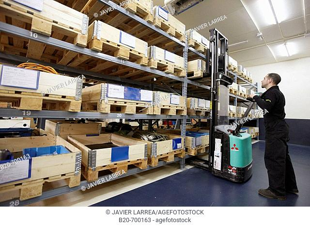Pallets in warehouse, forklift, spindle manufacturing. Mendaro, Gipuzkoa, Euskadi, Spain