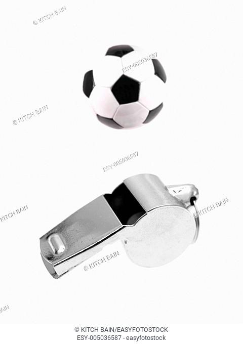 A sports watch and sports shoes isolated against a white background