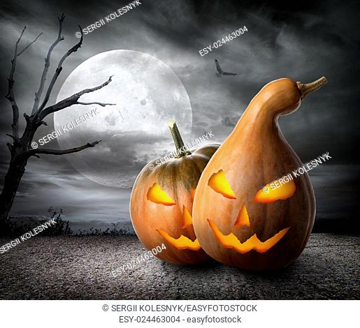 Angry pumpkins under fool moon. Elements of this image furnished by NASA