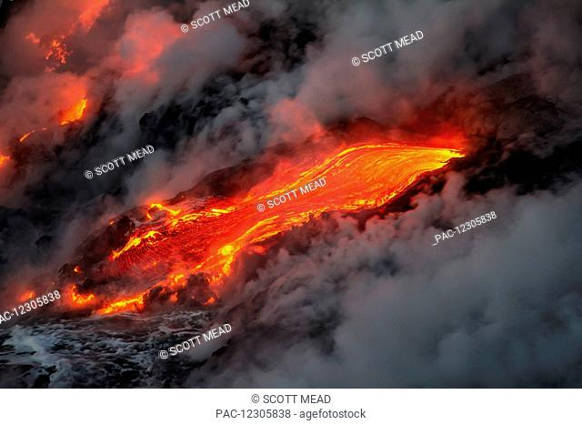Flowing lava and steam on a hawaiian island; Island of Hawaii, Hawaii, United States of America