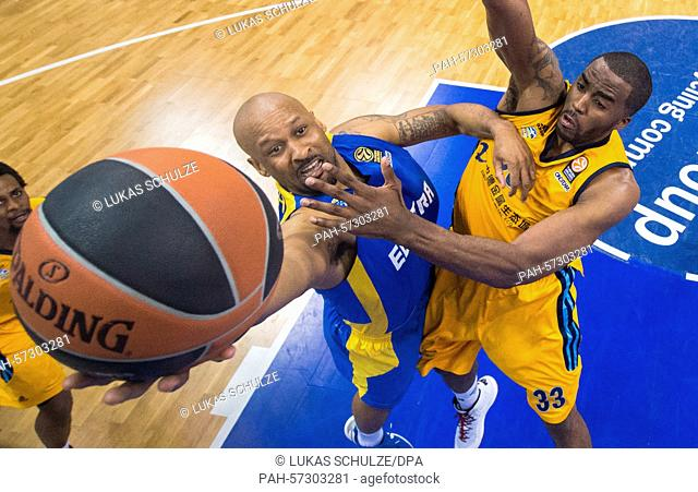 Tel Aviv's Devin Smith (L) and Berlin's Jamel McLean vie for the ball during the men's Euroleague basketball game between Alba Berlin and Maccabi Tel Aviv in O2...