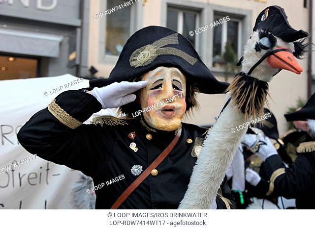 Salute from an ostrich riding participant in the Lucerne carnival