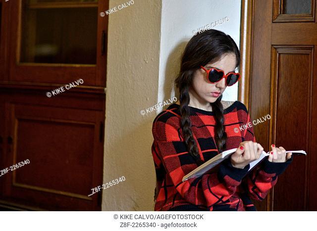 Teen student in uniform at school