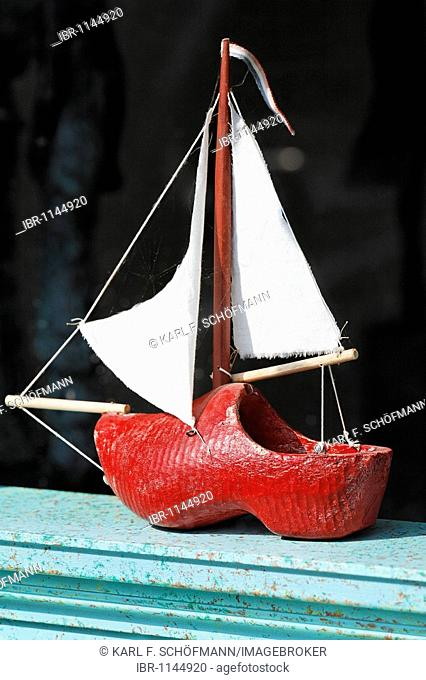 Small sailboat in the display window, made of Dutch wooden clogs, lettering Klompen, Dutch for clogs, handicrafted, De Rijp near Alkmaar