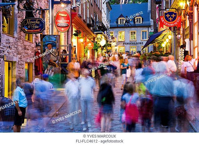 People on Sous le Fort street at dusk, Quartier Petit Champlain, Quebec city, Quebec