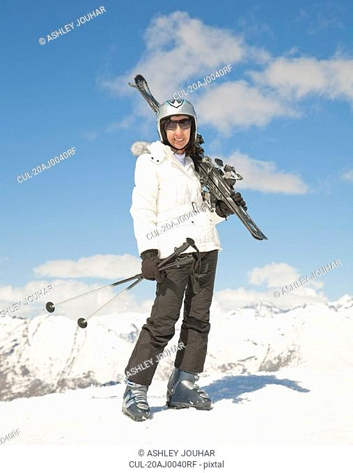 Woman with skis in mountain scene