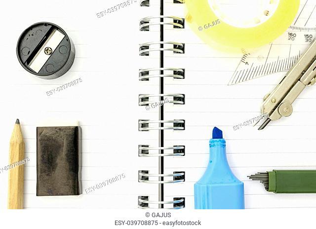 Various school supplies lying on notebook