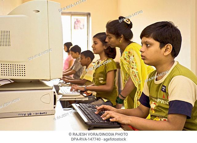 Computer classes for slum children run by NGO Triratna Prerna Mandal ; Santacruz ; Bombay now Mumbai ; Maharashtra ; India
