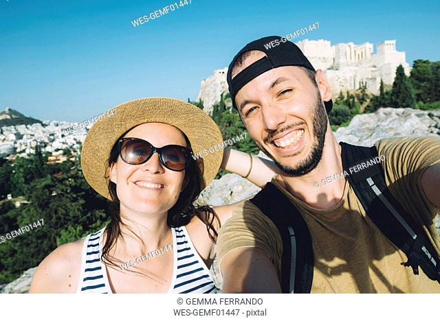 Greece, Athens, selfie of a couple with The Acropolis in the background
