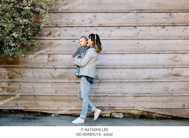 Mother holding baby boy, Venice Beach, Los Angeles, California, USA