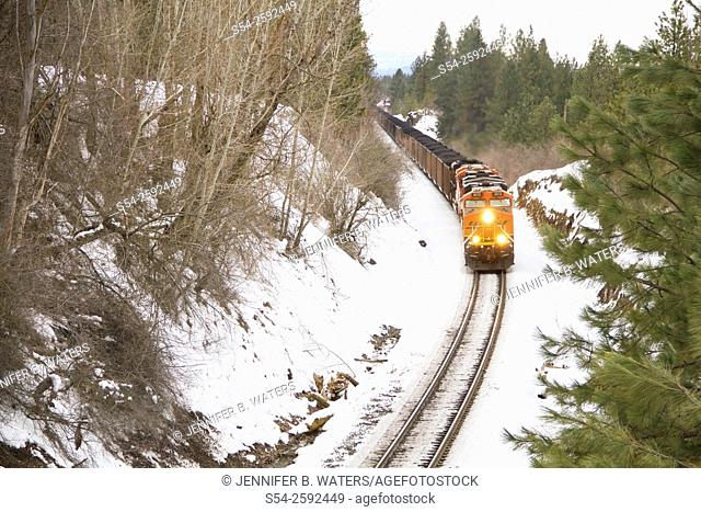 A Burlington Northern Santa Fe coal train heading west near Overlook siding in Spokane, Washington, USA in the winter