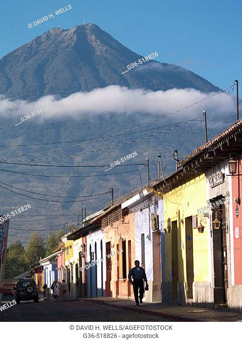 A view of the nearby vocano and the colorfully painted Colonial style houses in Antigua, Guatemala