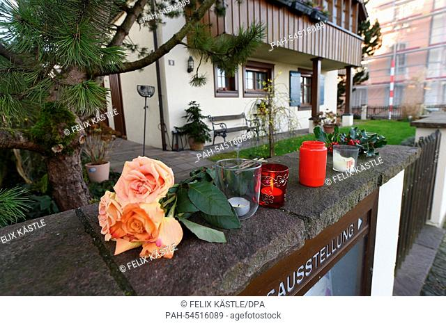 Flowers and burning candles lie and stand in front of the house of the late singer and composer Udo Juergens in Gottlieben, Switzerland, 22 December 2014