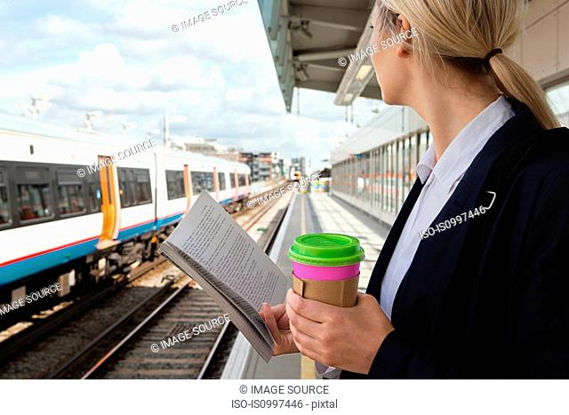 Businesswoman waiting for train