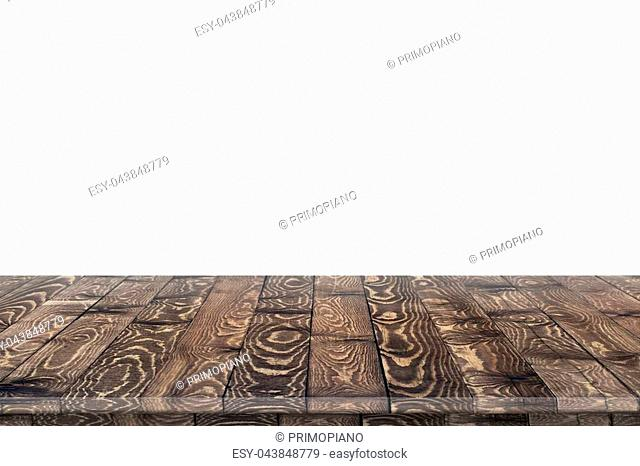Empty wooden table for product placement or montage with focus to table top in the foreground, with white background. Wooden board empty table perspective