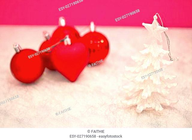 xmas decorations on pink with snow texture