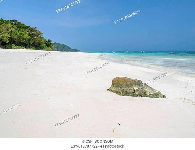 Rock on white sand beach of Tachai island, Thailand