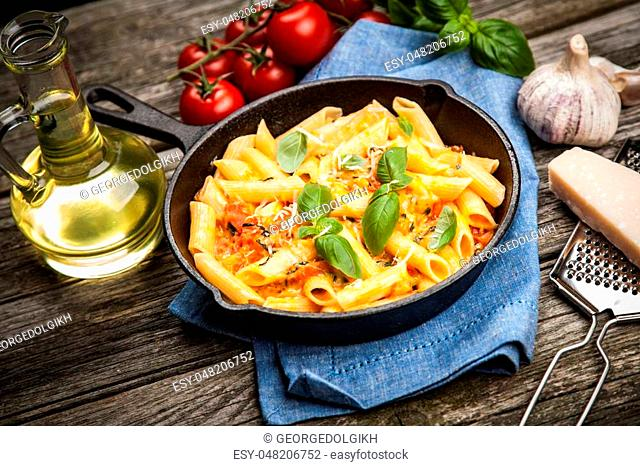 Traditional penne pasta in cast iron skillet