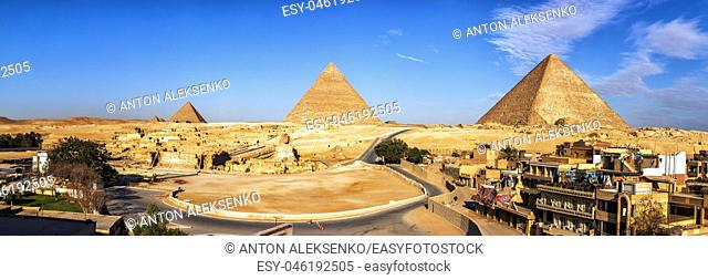 Giza Pyramids and living buildings in front of them, Egypt