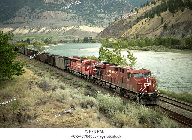 A CP (Canadian Pacific) coal train skirts along the Thompson River, through Spences Bridge, British Columbia, Canada. The coal is destined for the Port of...