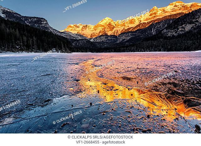 Sunrise Tovels lake on a cold winter day, Natural Park Adamello Brenta, Non valley, Trentino Alto Adige, Italy