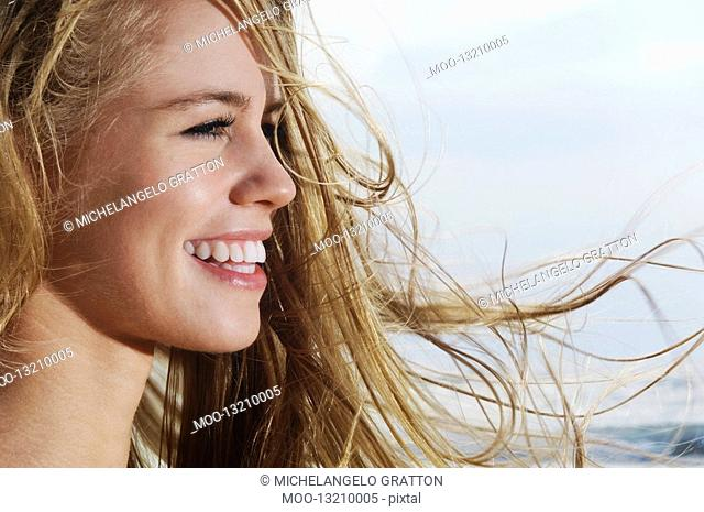 Smiling young woman profile close-up